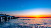 A Florida sunset viewed from the start of the Seven Mile Bridge in Knight's Key looking west-southwest toward the other end of the bridge in Little Duck Key.