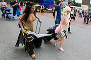 Tash Mackenzie, 25 Left, plays a Prsian Princess (after winning last years Cosplayer Competition as Zena) arrives with her burlesque dancer friend. London Film and Comic Con 2014, (LFCC), at Earls Court, London, UK.