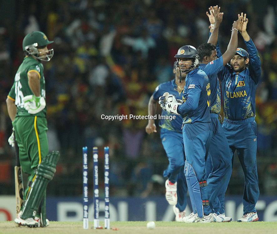 Ajantha Mendis celebrates the wicket of Imran Nasir as Kumar Sangakkara looks on during the ICC World Twenty20 semi final match between Sri Lanka and Pakistan held at the Premadasa Stadium in Colombo, Sri Lanka on the 4th October 2012<br /> <br /> Photo by Ron Gaunt/SPORTZPICS