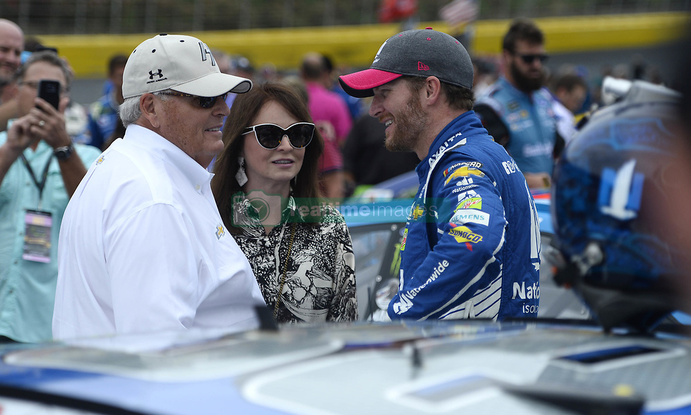 October 8, 2017 - Concord, NC, USA - NASCAR driver Dale Earnhardt Jr, right, talks with team owner Rick Hendrick , left, and Linda Hendrick prior to the start of the Bank of America 500 at Charlotte Motor Speedway in Concord, N.C., on Sunday, Oct. 8, 2017. (Credit Image: © David T. Foster Iii/TNS via ZUMA Wire)