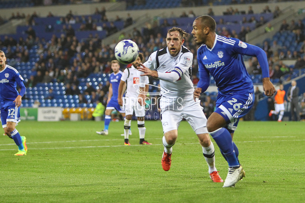 Richard Keogh of Derby County puts pressure on Kenneth Zohore of Cardiff City during the EFL Sky Bet Championship match between Cardiff City and Derby County at the Cardiff City Stadium, Cardiff, Wales on 27 September 2016. Photo by Andrew Lewis.