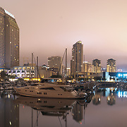 Downtown San Diego as seen on a cloudy night from Embarcadero marina park.