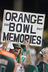 """A fan holds up a sign saying """"Orange Bowl Memories"""" during the last Miami Hurricanes game played in the 70 year old stadium.  The #19 Virginia Cavaliers defeated the Miami Hurricanes 48-0 at the Orange Bowl in Miami, Florida on November 10, 2007.  The game was the final game played in the Orange Bowl."""