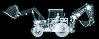X-ray image of a loader with backhoe (blue on black) by Jim Wehtje, specialist in x-ray art and design images.