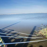 Nederland, Lelystad, 24 september 2016.<br /> Op zaterdag 24 september 2016 zet staatssecretaris Martijn van Dam van Economische Zaken (natuur) als eerste voet op de Marker Wadden. Natuurmonumenten legt samen met Rijkswaterstaat en Boskalis de komende jaren een archipel aan eilanden aan, die de natuur in het Markermeer een enorme impuls gaat geven. De staatssecretaris brengt samen met natuur- en watersportliefhebbers een bezoek aan het eerste eiland van dit innovatieve en grootschalige natuurproject. Dit eerste eiland omvat circa 250 hectare. De eerste fase van Marker Wadden omvat in totaal zo&rsquo;n 800 hectare, boven- en onderwaternatuur, en moet klaar zijn in 2020.<br /> Op de foto: Staatssecretaris Martijn van Dam duwt symbolisch een vruchtbaar eilandje vanuit de eerste Marker eiland het water in.<br /> <br /> Netherlands, Lelystad, September 24, 2016<br /> On Saturday, September 24th 2016 Martijn van Dam, secretary of Economic Affairs (nature) first sets foot on the Marker Wadden. Natuurmonumenten lays together with Rijkswaterstaat and Boskalis (Royal Boskalis Westminster N.V. is a leading global services provider operating in the dredging, maritime infrastructure and maritime services sectors) an archipelago of islands in the coming years that will give nature in the Markermeer a huge boost.<br /> Natuurmonumenten (Dutch Society for Nature Conservation) is going to restore one of the largest freshwater lakes in western Europe by constructing islands, marshes and mud flats from the sediments that have accumulated in the lake in recent decades. These 'Marker Wadden' will form a unique ecosystem that will boost biodiversity in the Netherlands. (source: www.natuurmonumenten.nl)<br /> The Secretary reunites with nature and water sports enthusiasts visiting the first island of this innovative and large-scale conservation project. This first island comprises approximately 250 hectares. The first phase of Marker Wadden comprises a total of 800 hectares, above and und