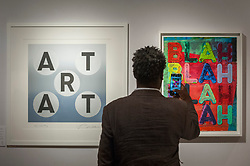 "© Licensed to London News Pictures. 29/06/2017. London, UK.  A man photographs (L to R) ""Art"", 2013, by Robert Indiana and ""Blah, Blah Blah"", 2017, by Mel Blochner.  Members of the public visit Masterpiece London, a leading art fair held in the grounds of the Royal Hospital Chelsea.  The fair brings together 150 international exhibitors presenting works from antiquity to the present day and runs 29 June to 5 July 2017.  Photo credit : Stephen Chung/LNP"