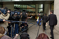 24 NOV 2003, BERLIN/GERMANY:<br /> Gerhard Schroeder, SPD, Bundeskanzler, laeuft auf dem Weg zur Sitzung des SPD Praesidiums an Mikrofonen und Kameras wartender Journalisten vorbei, Willy-Brandt-Haus<br /> IMAGE: 20031124-01-005.jpg<br /> KEYWORDS: Gerhard Schröder, microphone, camera, Journalist