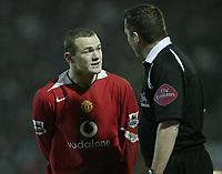 Photo: Aidan Ellis.<br /> Blackburn v Manchester United. Barclays Premiership. 01/02/2006.<br /> United's Wayne Rooney moans to the referee Phil Dowd