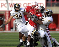 University of Nebraska running back Brandon Jackson (32) is wrapped up by Missouri linebacker Dedrick Harrington (33) in the fourth quarter at Memorial Stadium in Lincoln, Nebraska, November 4, 2006.  The Huskers defeated the Tigers 34-20.<br />