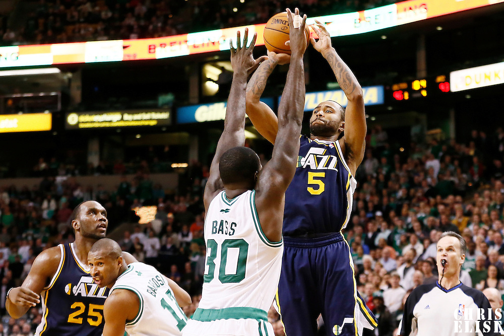 14 November 2012: Utah Jazz point guard Jamaal Tinsley (6) takes a jumpshot over Boston Celtics power forward Brandon Bass (30) during the Boston Celtics 98-93 victory over the Utah Jazz at the TD Garden, Boston, Massachusetts, USA.