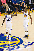 Golden State Warriors forward Draymond Green (23) and forward Kevin Durant (35) high five each other during a timeout against the Houston Rockets at Oracle Arena in Oakland, Calif., on December 1, 2016. (Stan Olszewski/Special to S.F. Examiner)