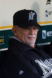 June 28, 2011; Oakland, CA, USA; Florida Marlins first base coach Perry Hill (7) sits in the dugout before the game against the Oakland Athletics at the O.co Coliseum.  Oakland defeated Florida 1-0.