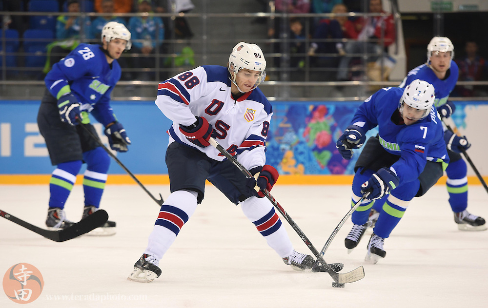 Feb 16, 2014; Sochi, RUSSIA; USA forward Patrick Kane (88) carries the puck ahead of Slovenia defenseman Klemen Pretnar (7) in a men's ice hockey preliminary round game during the Sochi 2014 Olympic Winter Games at Shayba Arena.