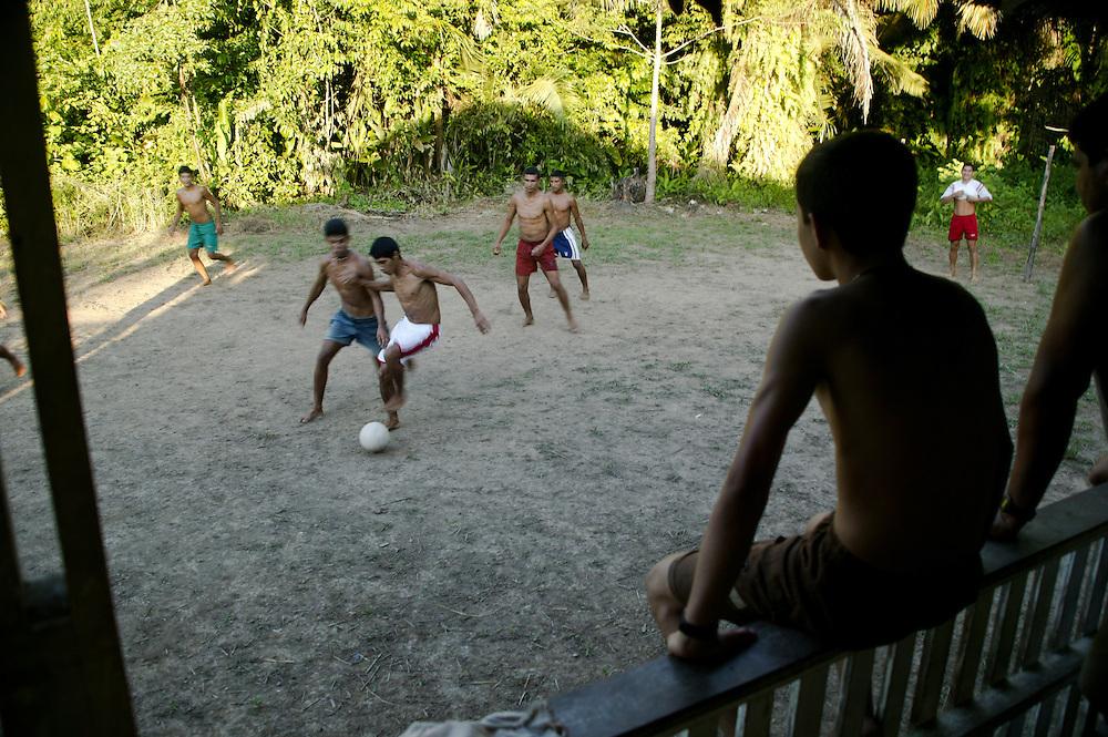 Nov. 7th, 2003. Men play football/soccer in Gurupa, Para State, Brazil.