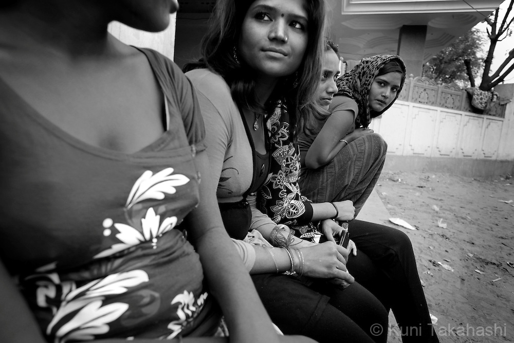 Young prostitutes wait for customers in Tilawada, a red light district, in Rajasthan, India. Many women from Ingonia stay in the district working as prostitutes.