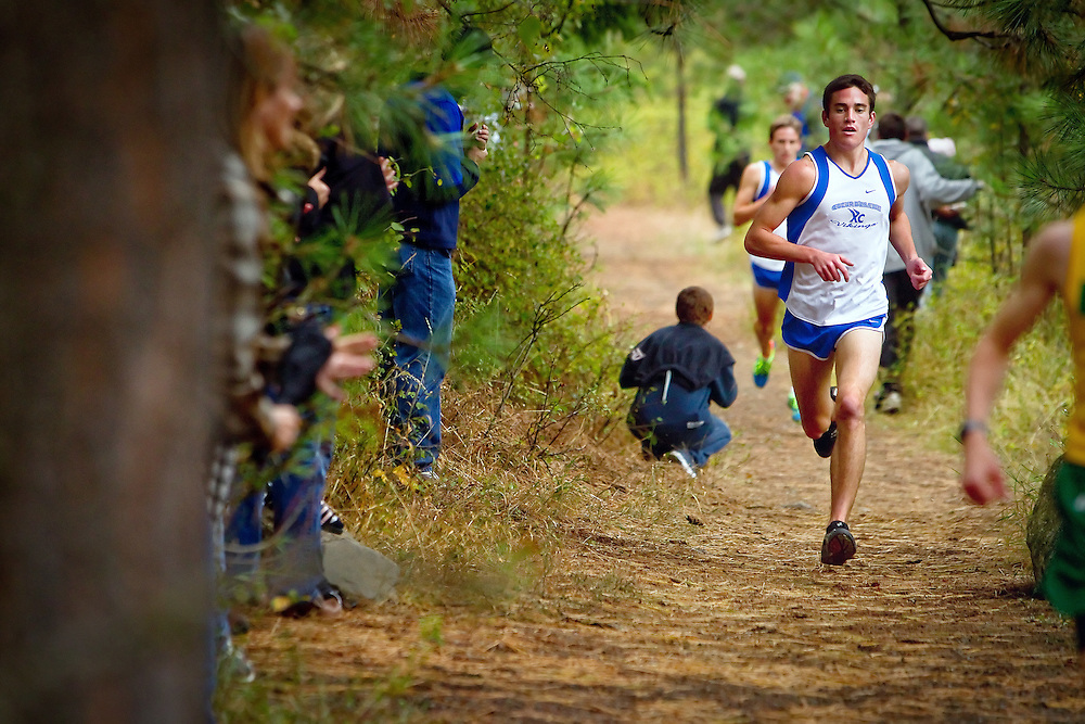 Coeur d'Alene High's David Norris on a tree lined trail along the 5k race Saturday at the Super One Invitational cross country races at Farragut State Park. Norris finished second in the race.