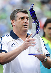 July 18, 2012: CenturyLink Field, Seattle, WA: Chelsea FC CEO Ron Gourlay accepts a blue spire during the World Football Challenge. Chelsea FC defeated the Seattle Sounders 4-2.