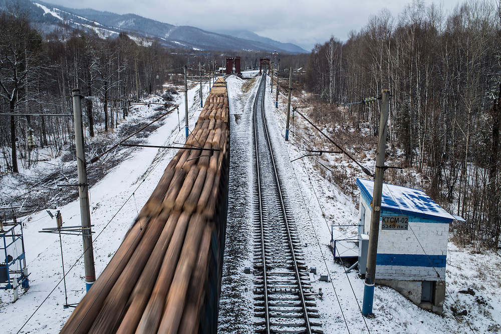A train carrying timber travels east, toward China, on Saturday, October 26, 2013 in Baikalsk, Russia.
