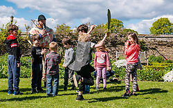 Medieval Day. Dirleton Castle, East Lothian, Scotland, United Kingdom, 11 May 2019. Pictured:  Historic Environment Scotland family fun day at the Living Medieval Village in the castle gardens.  Children learn to march in an army. Finn, aged 6 years, gets into the fighting spirit. <br /> <br /> Sally Anderson | EdinburghElitemedia.co.uk