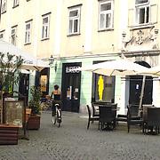 Cobbled street in the city centre of Ljubljana. Ljubljana, Slovenia.