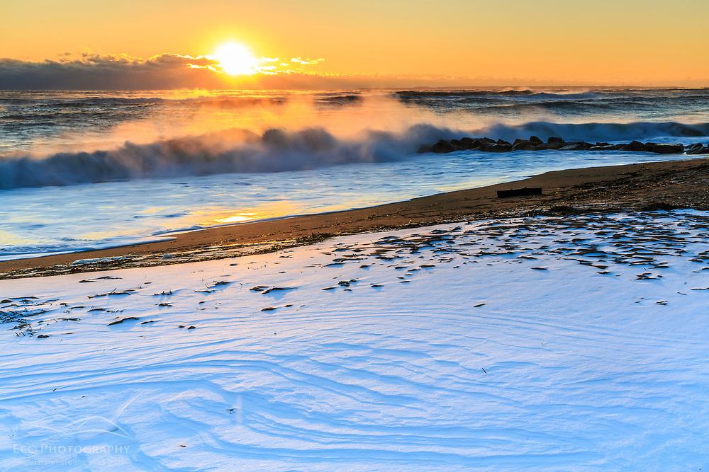 High surf after a winter storm on Plum Island in Newburyport, Massachusetts. Sunrise.