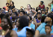 West Calumet Housing Complex resident Marina Barajas, center, listens to a comment during a public hearing regarding lead contamination in the soil of the complex Wednesday at the West Calumet Community Center in East Chicago.
