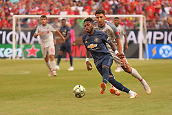July 28, 2018 - Ann Arbor, MI, U.S. - ANN ARBOR, MI - JULY 28: Manchester United Midfielder Fred Santos (17) dribbles away from Liverpool Forward Marko Grujic (16) in the second half of the ICC soccer match between Manchester United FC and Liverpool FC on July 28, 2018 at Michigan Stadium in Ann Arbor, MI. (Photo by Allan Dranberg/Icon Sportswire) (Credit Image: © Allan Dranberg/Icon SMI via ZUMA Press)