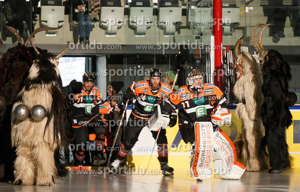 02.12.2016, Merkur Eisarena, Graz, AUT, EBEL, Moser Medical Graz 99ers vs HC TWK Innsbruck Die Haie, 25. Runde, im Bild Empfang der 99ers mit Sebastian Dahm (#31, Moser Medical Graz 99ers) durch eine Krampusgruppe // during the Erste Bank Icehockey League 25th Round match between Moser Medical Graz 99ers and HC TWK Innsbruck at the Merkur Ice Arena, Graz, Austria on 2016/12/02, EXPA Pictures © 2016, PhotoCredit: EXPA/ Erwin Scheriau
