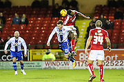 Swindon Town's Jonathan Obika beats Walsall's Jordan Cook in the air during the Sky Bet League 1 match between Swindon Town and Walsall at the County Ground, Swindon, England on 24 November 2015. Photo by Shane Healey.
