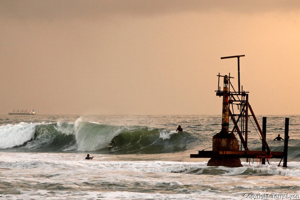 Pylon Repair, restoration of the Cottesloe pylon with a surfer in the tube