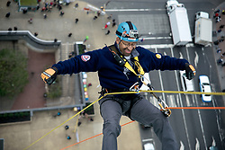 21 stories above ground level in Center City, Philadelphia, PA, USA - November 2, 2012; ..As they make the step over the edge rappellers have to overcome fair and rappel down more than 230ft. ..The participants first train at a one story instruction drop before heading for the big one. ..Philadelphia Mayor Michael Nutter is one of 'Fearless Rappellers'. Almost 70 attended the fundraising event, organized by Outward Bound Philadelphia and Over the Edge...Mayor Michael Nutter hangs free more than 230 feet above the ground.