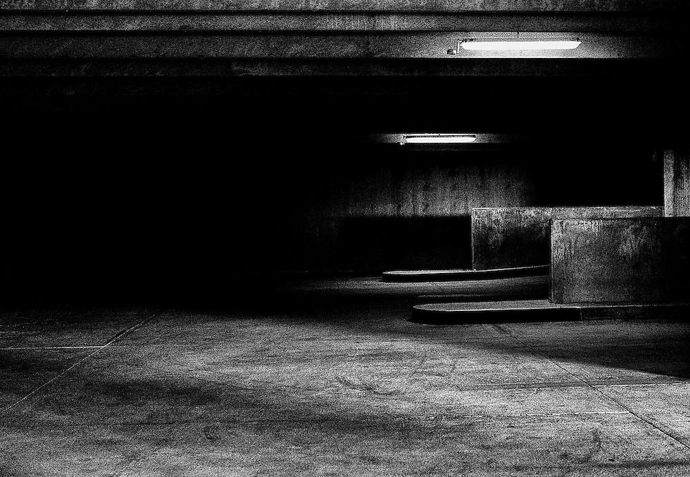 darkly lit parking garage