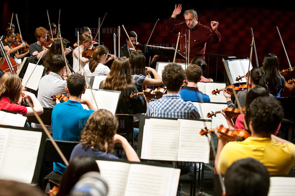 July 9, 2013 - Purchase, NY : Russian conductor Valery Gergiev, top center, leads the National Youth Orchestra of the United States of America in  rehearsal at SUNY Purchase's Performing Arts Center in Westchester on Tuesday afternoon. The Orchestra, a new project of Carnegie Hall's Weill Music Institute, is comprised of musicians aged 16-19, hand-picked from across the country. The program -- and orchestra -- will kick off its inaugural season with a performance at SUNY Purchase on Thursday evening, and then head off to perform in Washington DC,  Moscow, St. Petersburg, and London. CREDIT: Karsten Moran for The New York Times