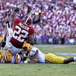 November 6, 2010; Baton Rouge, LA, USA; Alabama Crimson Tide running back Mark Ingram (22) is tackled by LSU Tigers linebacker Ryan Baker (22) and LSU Tigers cornerback Eric Reid (1) during the second half at Tiger Stadium. LSU defeated Alabama 24-21.  Mandatory Credit: Derick E. Hingle