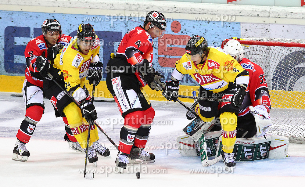 21.09.2012, Albert Schultz Eishalle, Wien, AUT, EBEL, UPC Vienna Capitals vs HC TWK Innsbruck, 5. Runde, im Bild Herbert Steiner, (HC TWK Innsbruck, #8), Jonathan Ferland, (UPC Vienna Capitals, #24), Craig Switzer, (HC TWK Innsbruck, #4), Tony Romano, (UPC Vienna Capitals, #8) und Patrick Machreich, (HC TWK Innsbruck, #33)  // during the Erste Bank Icehockey League 5th Round match betweeen UPC Vienna Capitals and HC TWK Innsbruck at the Albert Schultz Ice Arena, Vienna, Austria on 2012/09/21. EXPA Pictures © 2012, PhotoCredit: EXPA/ Thomas Haumer
