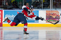 KELOWNA, CANADA -FEBRUARY 19: Mitch Topping #25 of the Tri City Americans takes a shot on net against the Kelowna Rockets on February 19, 2014 at Prospera Place in Kelowna, British Columbia, Canada.   (Photo by Marissa Baecker/Getty Images)  *** Local Caption *** Mitch Topping;