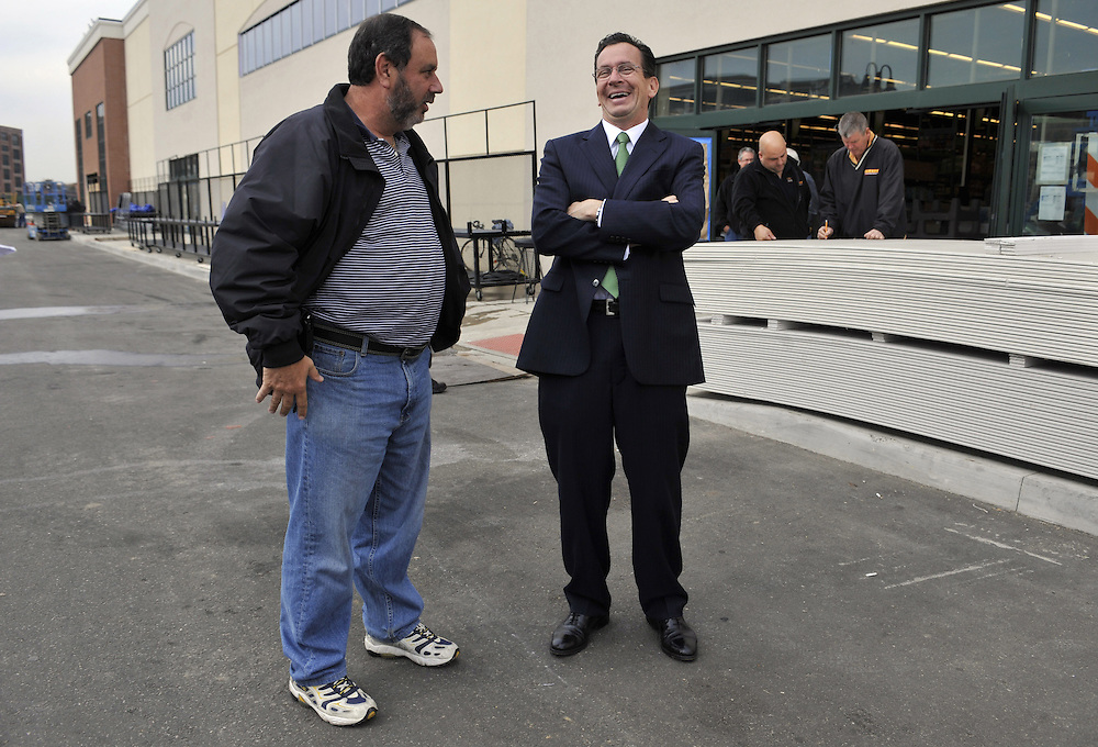 In this Oct. 20, 2010 photo, Democratic candidate for governor and former Stamford Mayor Dan Malloy, right, laughs while talking with  Aaron Fleishaker, vice president of real estate and construction for Fairway Market during a tour of the first store opening in Connecticut in the city of Stamford. (AP Photo/Jessica Hill)