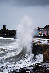 © Licensed to London News Pictures. 12/01/2017. Aberystwyth, Wales, UK. Stormy seas and strong winds batter the seafront in Aberystwyth on the west Wales coast, as the British weather deteriorates, with  'thundersnow' and bitterly cold conditions expected in much of the UK later today .  Photo credit: Keith Morris/LNP