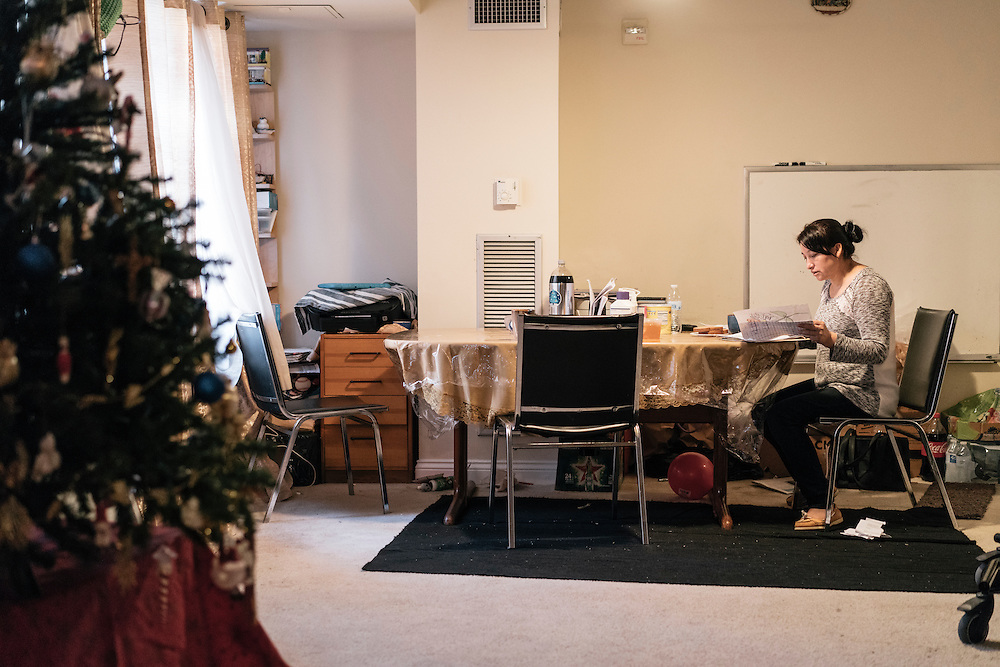 Eufronia Alba looks over her daughter, Danna's homework at her apartment in Arlington, Va. on Dec. 15, 2016. Alba and her husband, undocumented Bolivians, were in deportation proceedings but have requested cancellation of removal because Joshua, who is American-born, has cerebal palsy and depends on his parents for everything including bathing and feeding. CREDIT: Greg Kahn / GRAIN for the Wall Street Journal TRUMPLOOP