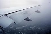 wing of passenger airplane in cloud fog during landing