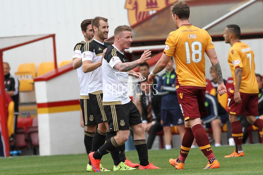 Celebrating Niall McGinns goal during the Ladbrokes Scottish Premiership match between Motherwell and Aberdeen at Fir Park, Motherwell, Scotland on 15 August 2015. Photo by Craig McAllister.