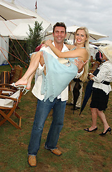ANOUSKA DE GEORGIOU and DAVID FISHER at the 2005 Cartier International Polo between England & Australia held at Guards Polo Club, Smith's Lawn, Windsor Great Park, Berkshire on 24th July 2005.<br />
