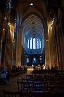 Our Lady of Chartres Cathedral, Chartres, France. View from the Labyrinth down to the altar showing the vaulting, columns, archways and congregational seating.