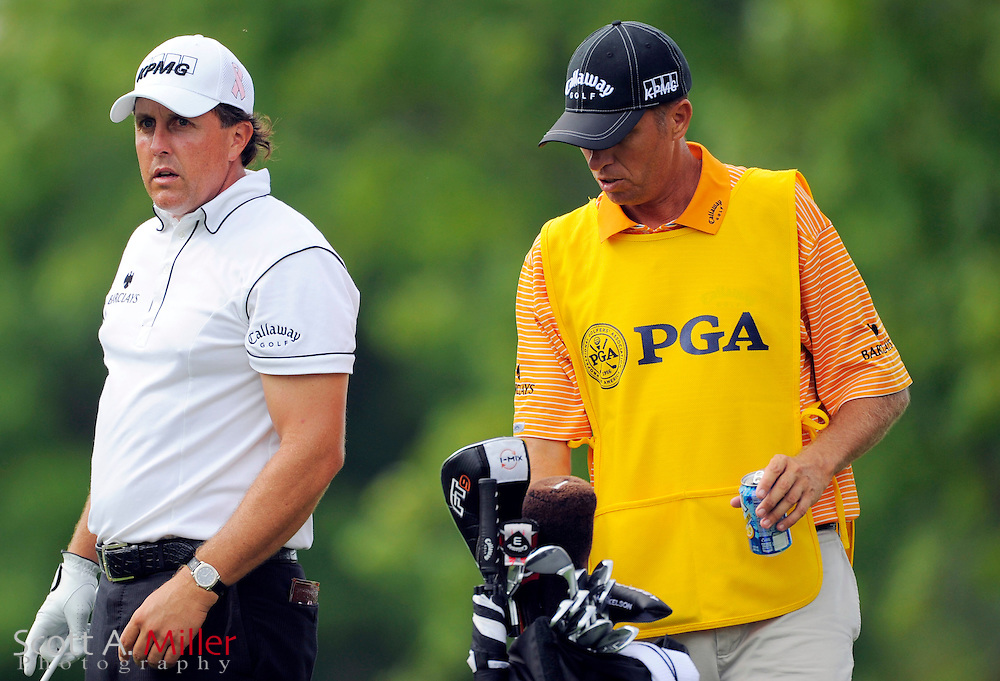 Aug 13, 2009; Chaska, MN, USA; Phil Mickelson (USA), left, and his caddie during the first round of the 2009 PGA Championship at Hazeltine National Golf Club.  ©2009 Scott A. Miller