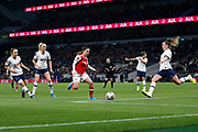 Anna Filbey clears the ball under pressure from Danielle Van De Donk during the FA Women's Super League match between Tottenham Hotspur Women and Arsenal Women FC at Tottenham Hotspur Stadium, London, United Kingdom on 17 November 2019.