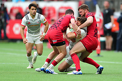 March 9, 2019 - Vancouver, BC, U.S. - VANCOUVER, BC - MARCH 09:  Steve Tomasin (9)  of the United States is tackled by Ben Roach (12) and Owen Jenkins (5) of Whales during day 1 of the 2019 Canada Sevens Rugby Tournament on March 9, 2019 at BC Place in Vancouver, British Columbia, Canada. (Photo by Devin Manky/Icon Sportswire) (Credit Image: © Devin Manky/Icon SMI via ZUMA Press)