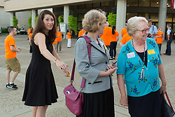 Kentucky Secretary of State Alison Lundergan Grimes, left, says hello to Nancy Jo Kemper, right, outside the 53rd Annual Kentucky Farm Beureau Country Ham Breakfast. The annual charity event was protested by Congressman John Yarmuth, Chris Hartman and other members of various fairness organizations outside the South Wing of the Kentucky Fair and Exposition Center, Thursday, Aug. 25, 2016 in Louisville.