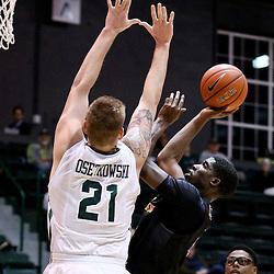Feb 24, 2016; New Orleans, LA, USA; East Carolina Pirates forward Michel Nzege (13) shoots over Tulane Green Wave forward Dylan Osetkowski (21) during the first half of a game at the Devlin Fieldhouse. Mandatory Credit: Derick E. Hingle-USA TODAY Sports