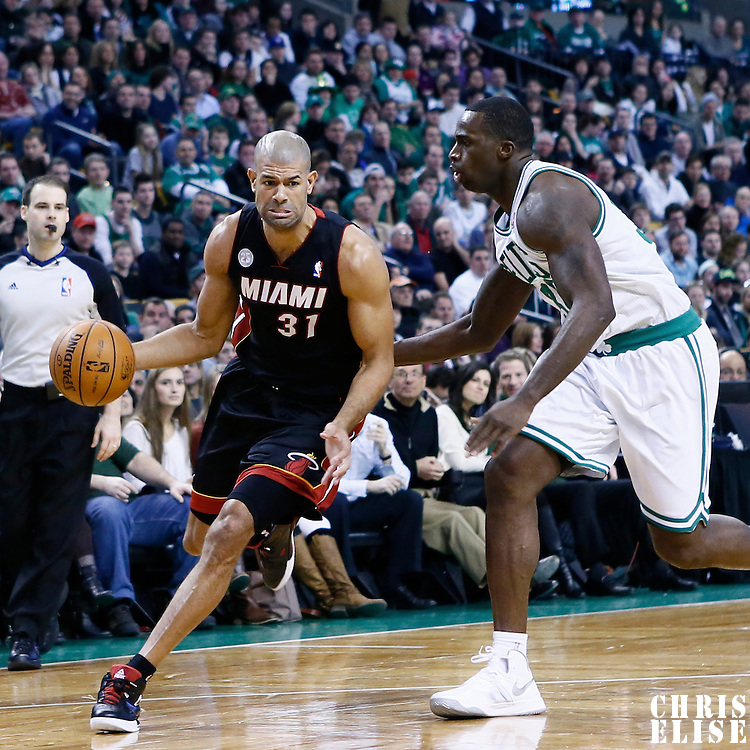 27 January 2013: Miami Heat small forward Shane Battier (31) drives past Boston Celtics power forward Brandon Bass (30) during the Boston Celtics 100-98  2OT victory over the Miami Heat at the TD Garden, Boston, Massachusetts, USA.