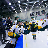 1st year defender Mariah McKersie (20) of the Regina Cougars celebrates during the Women's Hockey Home Game on November 26 at Co-operators arena. Credit: Arthur Ward/Arthur Images